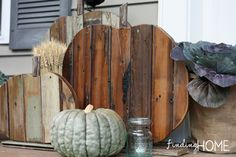 Fall Decorating Ideas: Step by step tutorial of how to decorate outdoors for fall with DIY Reclaimed Wood Pumpkins.