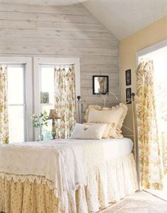 pretty cottage bedroom - love the yellow and whit linens