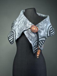 Chica Chimu cave art inspired felt sleeveless jacket worn as a bolero. Double sided felt