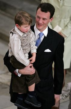 Prince Joachim of Denmark carries his son Prince Felix of Denmark as they leave the Royal Christening of Prince Christian, son of TRH Crown Prince Frederik of Denmark and Crown Princess Mary of Denmark, at Christiansborg Palace Church on January 21, 2006 in Copenhagen, Denmark. The new Prince was born on October 14, 2005 at Copenhagen University Hospital and is the first child for the Royal couple. (January 21, 2006 - Source: Chris Jackson/Getty Images Entertainment)