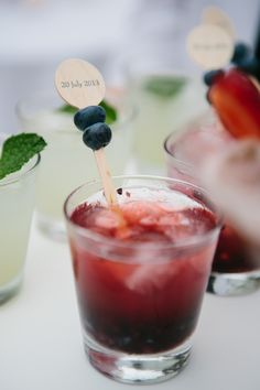 Signature blueberry cocktail for summer wedding | Photography: Heather Kincaid - heatherkincaid.com  Read More: http://www.stylemepretty.com/california-weddings/2014/05/23/romantic-elegance-at-bel-air-private-estate/