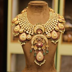 Fashion Jewelry Necklace Gold bridal jewellery with red and green beads Indian Jewelry Earrings, Indian Jewelry Sets, Jewelry Design Earrings, Indian Wedding Jewelry, Gold Jewellery Design, Fashion Jewelry Necklaces, Bridal Jewelry Sets, Bridal Necklace, Gold Jewelry