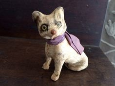 Late 19th C Composition Cat covered in flannel ; German in origin, similar to candy containers and squeaks of this era but only a sitter. Measures 3