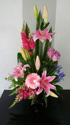 Cute arrangement with stargazer lilies, gerbera daisies, snapdragons, and roses