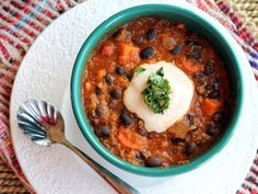 A bowl of black bean, sweet potato, and quinoa chili will keep you full and satisfied, while also delivering some major protein.