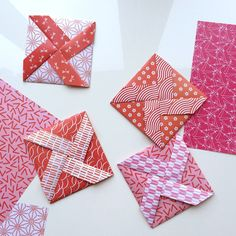Pinwheel letters / download the template and get instructions via the blog. Also get the cute Valentines' red/pink origami paper - free download, of course.