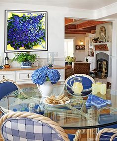 The yellow and blue violet painting is a great balance to the plaid.