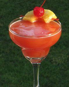 Psycho   1.5 oz. Light Rum, .5 oz Galliano, 2 oz. Orange Juice, 2 oz. Pineapple Juice .5 oz Grenadine, Pineapple wedge and Cherry for garnish