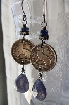 Reconstructed vintage Irish circulated half a sixpence rabbit or hare coins are now dangle earrings. I used tiny faceted iolite gemstone beads and