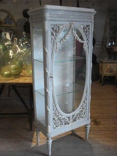 Could you recycle one of the those old doors with the oval glass to come up with a similar look?  Love the look.