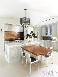 T-shaped island marble trimmed hood via atlanta homes Kitchen Inspirations, Home Kitchens, Marble Kitchen Island, Kitchen Marble, Kitchen Design, Kitchen Island With Seating, Kitchen Island Design, Kitchen Remodel, Kitchen Dining Room