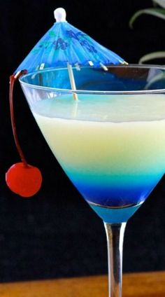 Pina Colada-tini - 2 oz. rum, 1 oz. coconut rum, 2 oz. pineapple juice, 1 oz. cream of coconut,1/2 oz. blue curaçao Garnish as desired