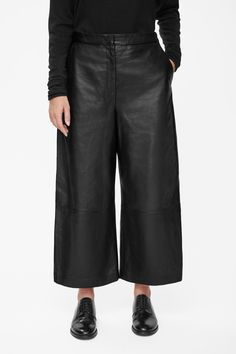 Made from soft leather, these modern oversized cropped trousers are a wide-leg style that taper slightly towards the ankle. Designed to sit between the hip and waist, they have a dropped crotch, partial silky lining, slanted front pockets and a classic zip fly fastening.