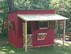 Our Goathouse! Still have to add a wooden porch floor (will add pic when it's done). Includes inside and outside hay feeders, triple bunk beds inside, dutch door and two windows with shutters for added airflow! Might still and some white trim work.