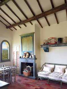 The house in Civita features light-flooded interiors built over a network of Etruscan caves and furnished with 18th-century provincial antiques found on Michele's travels in Italy, France, and England.