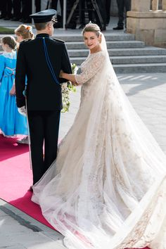 And she walked down the aisle in a resplendent Elie Saab gown which had a 13 foot train!!
