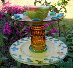Come to the Golden Garden!  This piece all started with the amber glass tumbler accented with vintage, recycled, and new elements to add charm to your garden.
