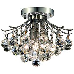 @Overstock - Dazzling crystal globe droplets fall from the arms of this chrome flush-mount chandelier. Four halogen lights in the center create a stunning light display that would give sparkle and shine to any room of your home. This item is hard-wired.http://www.overstock.com/Home-Garden/Elegant-Lighting-3-light-Chrome-Flush-Mount-Chandelier/6434166/product.html?CID=214117 $127.99