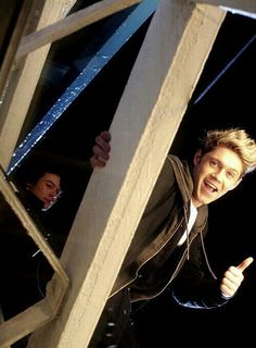 Niall is all happy and Harry's trying to hide how scared he is lol