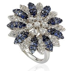 This dazzling sapphire ring compliments you with natural blue sapphires, created white sapphires, fancy brown diamonds and, hand set in sterling silver, with a unique designer Suzy Levian gallery and 18K gold logo.