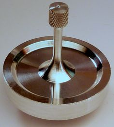 """The """"Au Natural"""" version of the Spinny-Doo Precision Spinning Top. Plain, shiny, and oh you so want to play with one :-)"""