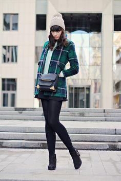 Plaid coat and a warm hat.