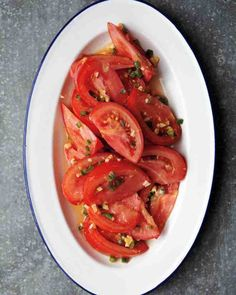 Minced ginger, lemon zest, and fresh jalapeno or serrano chile add an exciting bite to the standard tomato salad. Pair this easy side dish with grilled tuna, mahi mahi, or steak.