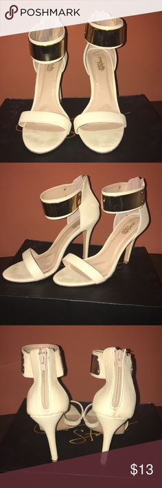 Nude and gold single strap heel sandal This is a sexy nude heel sandal that will glam up your outfit with the gold buckle in the front. Only warn once. Charlotte Russe Shoes Heels