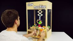 How to Make Hydraulic Powered Claw Machine from Cardboard In this video I show you how to make amazing working hydraulic powered claw machine from cardboard at home. You need cardboard, popsicle sticks, syringes, pipes and of course toys :) Enjoy :). Diy Crafts For Kids, Fun Crafts, Paper Crafts, 5 Minute Crafts Videos, Craft Videos, Science Videos, Science Projects, Projects To Try, Soda Fountain Machine
