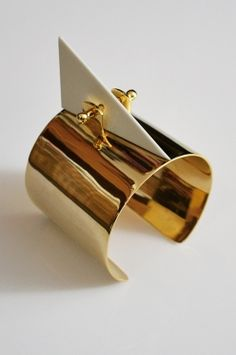 Pyramid cuff made from gold plated and powder coated brass. By Gala Curios.