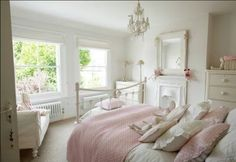 The blush pink bedspread, the fireplace, the radiators, stunning room