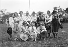 Rodeo Cowgirls, ca. 1925. Standing from left: Florence Hughes Randolph, Ruth Roach, Mabel Strickland, Reine Hafley Shelton, Mildred Douglas, Bonnie McCarroll, Rose Smith, Maud Tarr; squatting from left: Bea Kirnan, Mayme St...