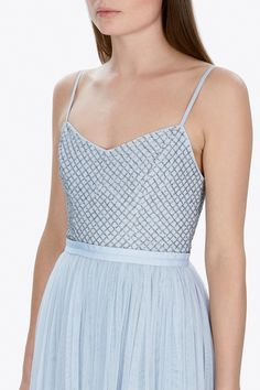 Inspired by the ballet, the blue Coppelia Ballet Dress has a soft, fitted bodice to the waist, embellished with a simple grid mesh artwork. The grid mesh is made up of tiny silver cut beads that are unevenly cut at the edges, for that extra sparkle as they catch the light. The bodice features delicate, adjustable straps and a grosgrain waistband. The bodice extends into layers of frothy tulle, subtly contrasting in colour to create depth, tone and movement. The skirt finishes just below the…