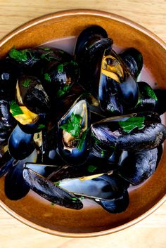 NYT Cooking: This is absolutely the simplest way to cook mussels, and perhaps the most satisfying. A big pot of them makes an easy, festive dinner any night of the week. Fish Dishes, Seafood Dishes, Fish And Seafood, Mussels Seafood, Steamed Mussels, Seafood Boil, Fish Recipes, Seafood Recipes, Cooking Recipes