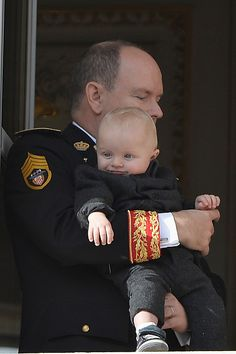 Prince Albert II of Monaco with Prince Jacques greet the crowd from the palace's balcony during the Monaco National Day Celebrations on November 19, 2015 in Monaco, Monaco.