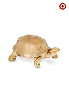 Made of gold ceramic, this tortoise has a secret. Lift the shell and you'll discover a hidden decorative dish that holds keys, a treasured keepsake, a note to your sweetie…or whatever.