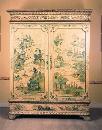 A George III yellow and green japanned wardrobe Decorated overall with floral borders, the dentil-moulded cornice above a pair of doors each decorated with Oriental pavillions, on bracket feet   sold for $32,840
