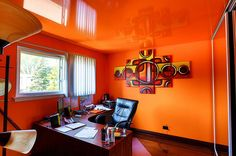 Bright Vibrant Home Offices with Bold Orange Brilliance With Orange Wall Wall Art Glass Window White Curtain Wooden Table Black Desk Wooden Floor