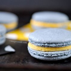 Wild blueberry tinted macarons, filled with a mouth-watering mango white chocolate ganache.