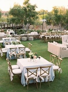Gorgeous outdoor reception set up with square tables