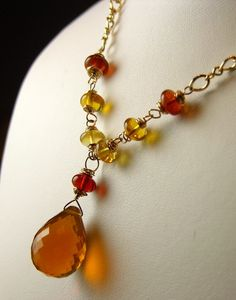 This pendant made from a 17.2mm x 12.2mm Oregon Fire Opal Briolette and 6mm Oregon Fire Opal rondelle beads is a beautiful example of the sweep of color available in this opal. Strung on a gold-filled chain. $89.00 Another stunning example of the riches found in the Pacific Northwest.