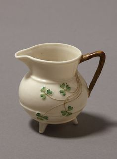 I have several old pieces, love love.   Belleek pottery cream jug, c.1884, from Fermanagh, (Northern) Ireland, adorned with shamrocks, a symbol of Ireland. (Victoria & Albert Museum)