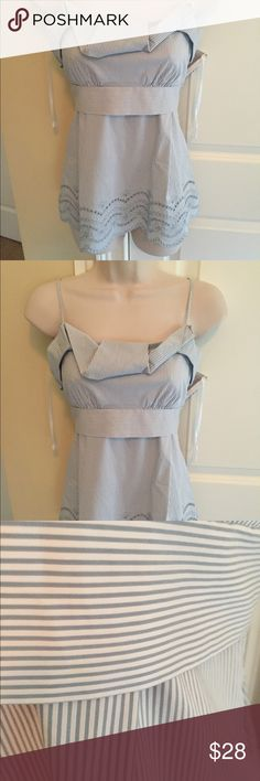 Bcbgmaxzaria XS front cut out print top Could fit a size small as well. Beautiful scallop eyelet hem. Bluish/gray pinstripe design. EUC. Hidden side zip, ties in the back for best fit. Common blend. 65 cotton, 28 nylon/oninlon 4 spandex. Laying flat, measuring from shoulder to hem is approx. 16.5 in, adjustable straps. Excellent condition BCBGMaxAzria Tops Blouses