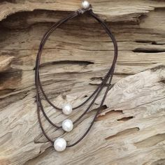 Stunning! VERY LARGE triple strand freshwater pearl and leather necklace. These pearls have a gorgeous luster are a very rare size measuring about 14-15mm each. Great, simple piece you will enjoy wear