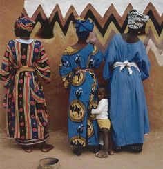 Soninke women in Djajibinni, Mauritania hand painting design on wall.