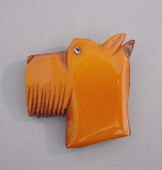 Bakelite butterscotch and wood carved dog head brooch