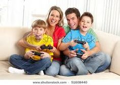 Video games are a popular form of entertainment for today's kids. Like all entertainment, their use must be monitored by parents to avoid a negative impact. What parents can do about video games Family Games, Games For Kids, Family Activities, Kids And Parenting, Parenting Hacks, Teaching Kids, Kids Learning, Professor, Family Stock Photo
