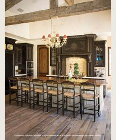 Love the floor.  and the dark cabinets and light island.  Not the beams though.