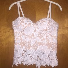 Sans Souci crop top Super super cute crop top I bought at TJ Maxx, never worn. So cute but doesn't fit me right. It's sheer lace with a nude slip underneath- also has a semi-built-in-bra and adjustable straps. Excellent condition! Sans Souci Tops Crop Tops