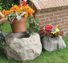 Blossom Boulders - Faux Rock Planters - make from ferrocement / on't plant your flowers in mere terra-cotta pots when you can grow them in full blown boulders with these cool new Blossom Boulders - Faux Rock Planters. These hollow, lightweight and weather-resistant fake rocks feature a realistic texture and finish, have built-in drainage and can be used as traditional planters or as containers for pre-planted pots.
